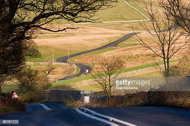winding country road - ryan mcginnis stock photos and pictures