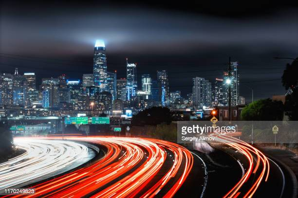 winding highway near san-francisco downtown at night - urban sprawl stock pictures, royalty-free photos & images