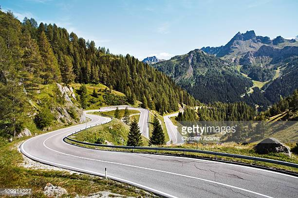 winding mountain path - mountain road stock pictures, royalty-free photos & images