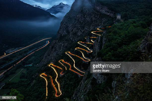 Winding Mountain Road at night with traffic lights