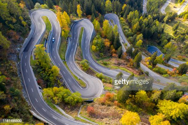 winding mountain road, maloja pass, swiss alps - switzerland stock pictures, royalty-free photos & images