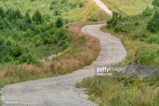winding mountain road - bending stock pictures, royalty-free photos & images