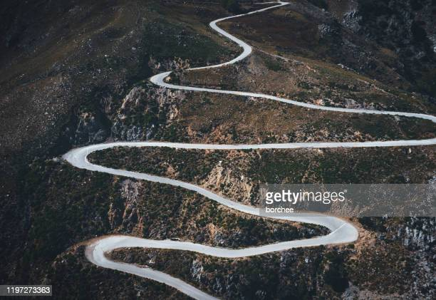 winding mountain road - bent stock pictures, royalty-free photos & images