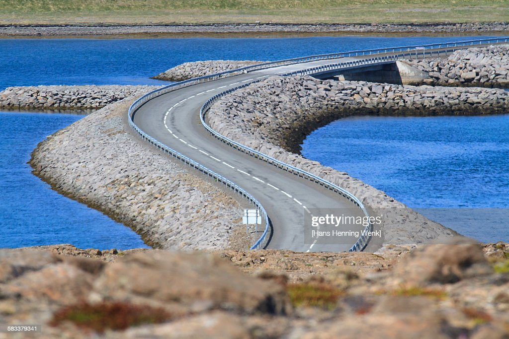 Winding road across river : Stock Photo