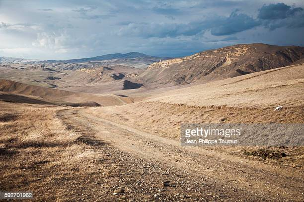 winding road across the georgian desert near david gareja monastery, kakheti region, eastern georgia. - extreme terrain stock pictures, royalty-free photos & images