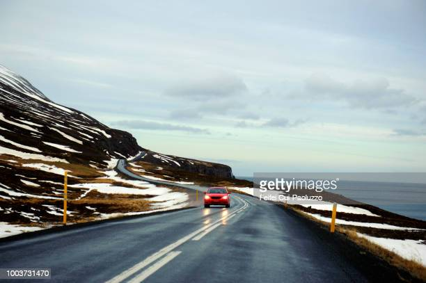 winding road at reydarfjördur, eastern iceland - austurland stock pictures, royalty-free photos & images