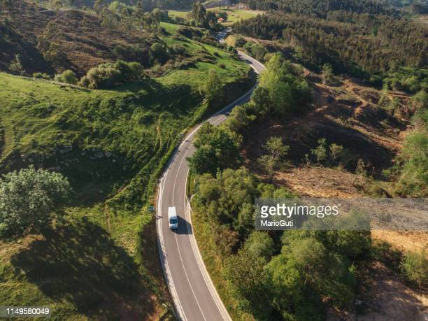 winding road from above - commercial land vehicle stock pictures, royalty-free photos & images