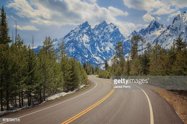 winding road in grand teton national park, wyoming, usa - grand teton national park stock pictures, royalty-free photos & images