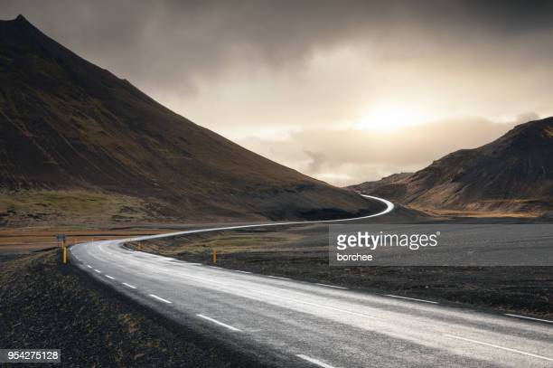 winding road in iceland - curve stock pictures, royalty-free photos & images