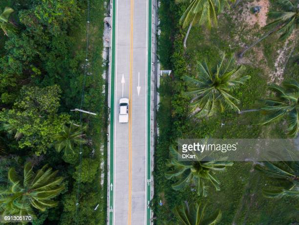 winding road in thailand - curved arrows stock photos and pictures