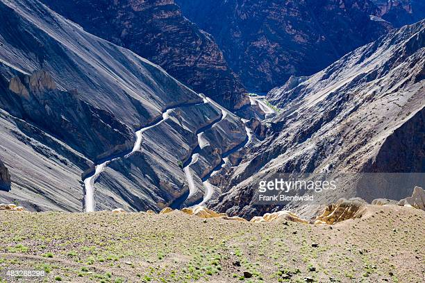 A winding road is leading up to Lamayuru Gompa a monastery located in barren landscape