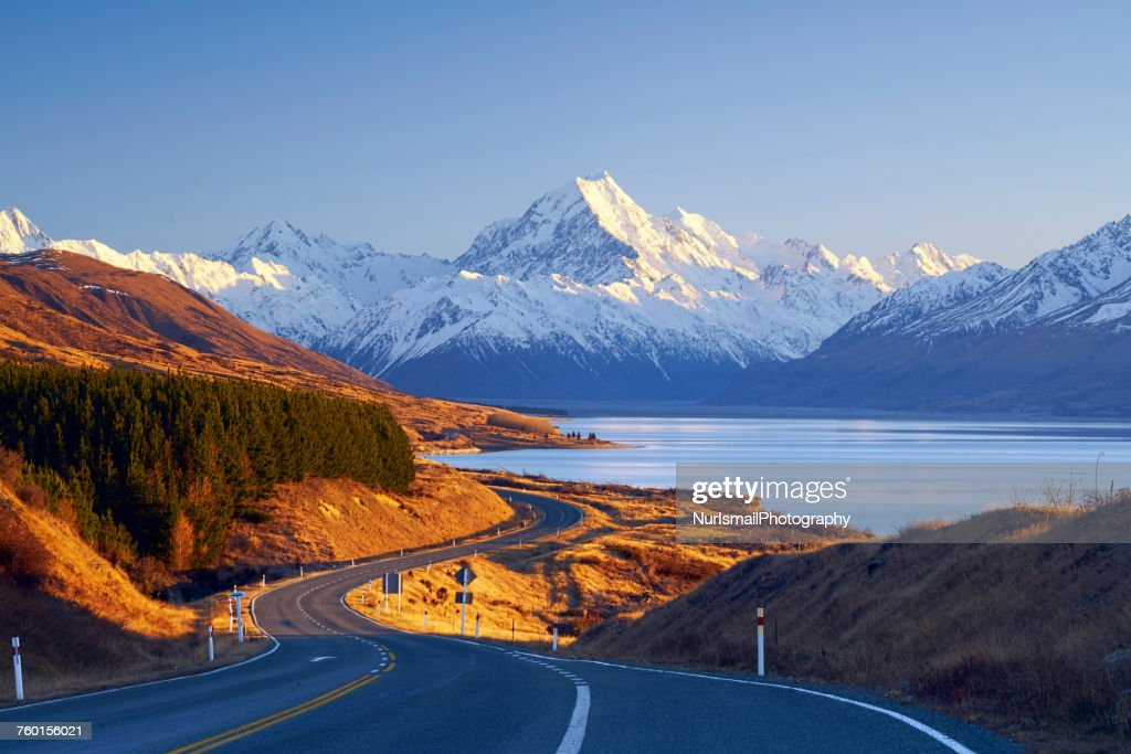Winding road leading to Mount Cook Village, Canterbury, South Island, New Zealand : Stock Photo