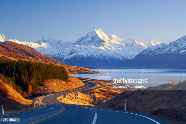 winding road leading to mount cook village, canterbury, south island, new zealand - new zealand stock pictures, royalty-free photos & images