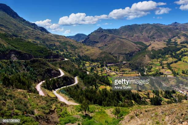 Winding road leading up to Inca terraces of Pisac on autumn afternoon, Sacred Valley, Peru