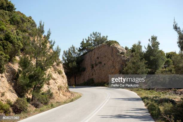 winding road near limenaria, in thasos island, east macedonia and thrace region, northern greece. - thasos stock photos and pictures