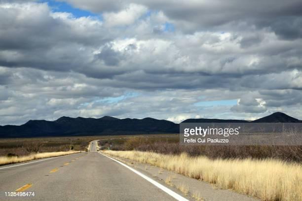 winding road near tombstone, arizona, usa - tombstone arizona stock pictures, royalty-free photos & images