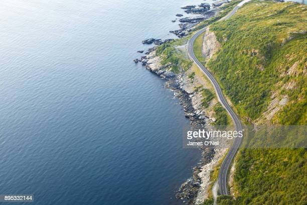 Winding road next to ocean viewed from above, Lofoten, Norway