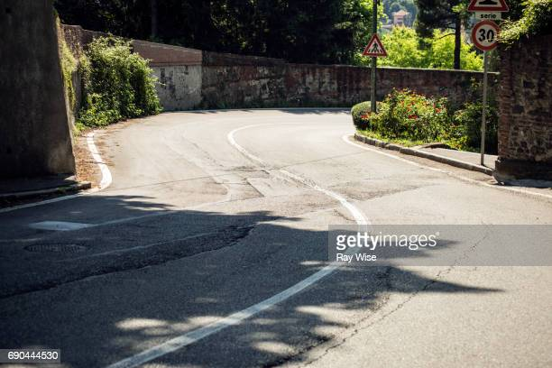 winding road on hill in turin, italy. - s shape stock photos and pictures