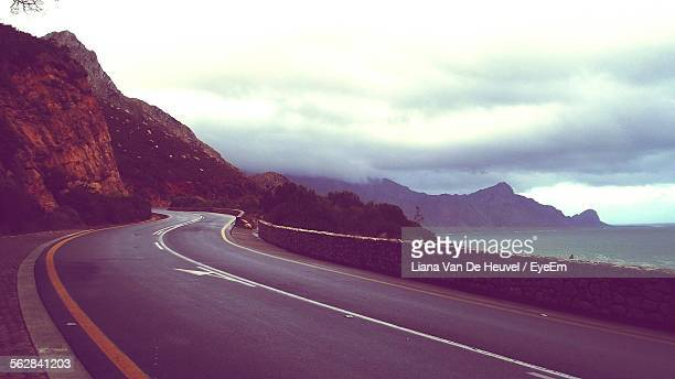 Winding Road Passing Through Mountains