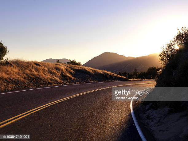 winding road - california sunset stock pictures, royalty-free photos & images
