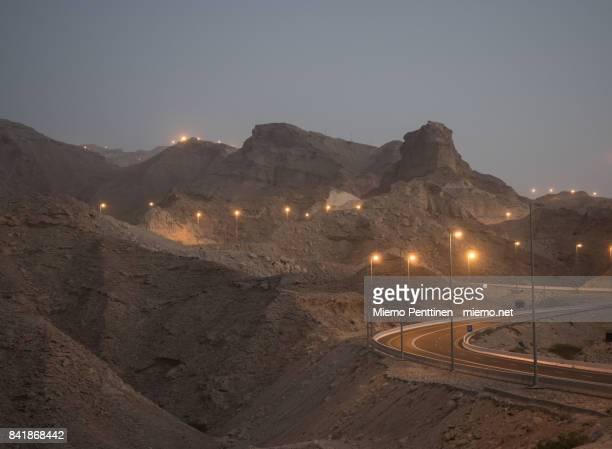 Winding road rising to Jebel Hafeet mountain in Al Ain, UAE