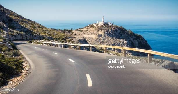 キャップ フォーメントー灯台への道の巻 - 海岸線 ストックフォトと画像