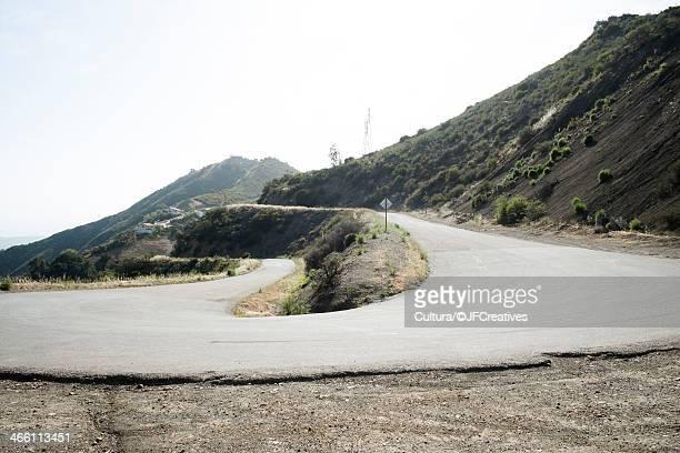 winding road up mountain, santa barbara, california, usa - hairpin curve stock photos and pictures