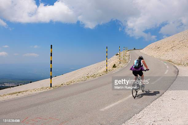 Winding road with bicyclist at Mont Ventoux.