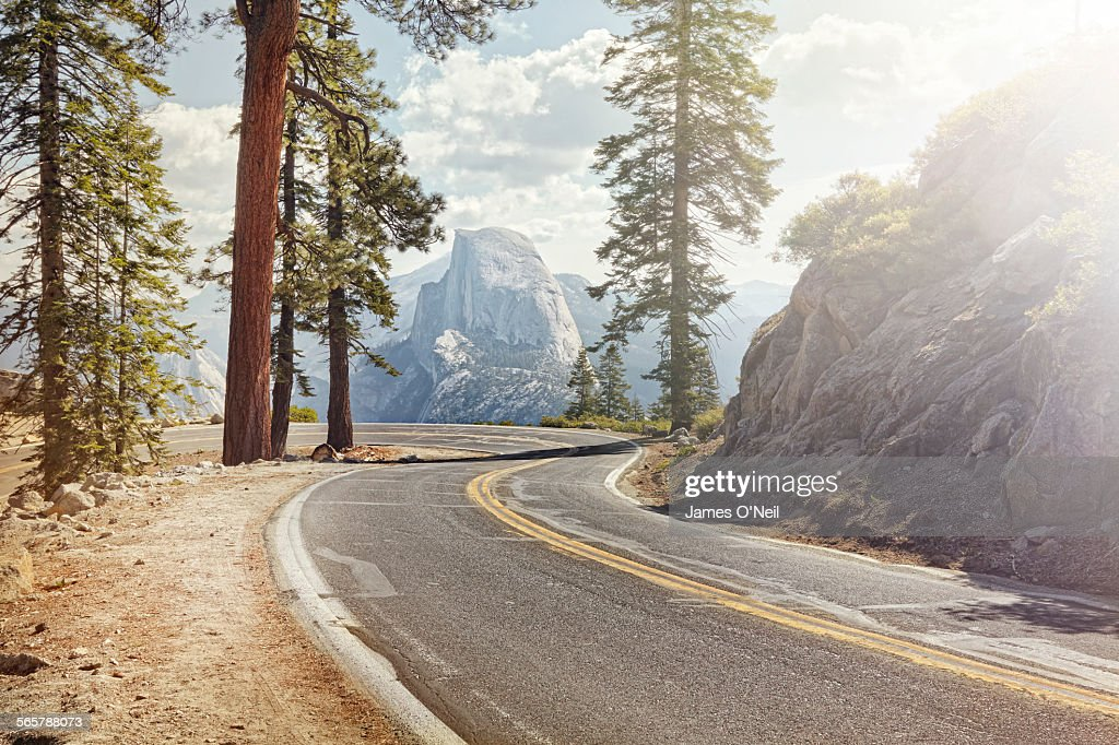 winding road with half dome in yosemite : Stock Photo