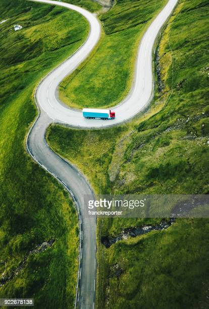 winding roads at faroe islands - bay of water stock pictures, royalty-free photos & images