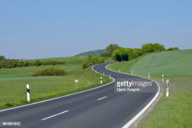 winding rural road. - martin stange stock-fotos und bilder