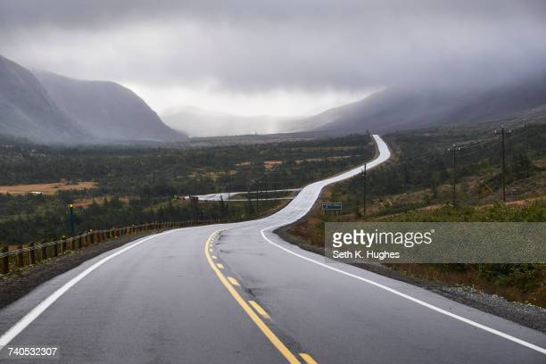 winding rural road through gros morne national park, newfoundland, canada - newfoundland and labrador stock pictures, royalty-free photos & images