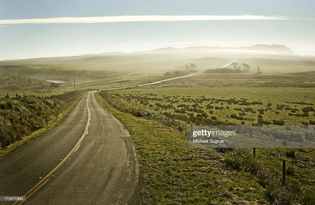 Winding scenic road in a green countryside. : Stock Photo