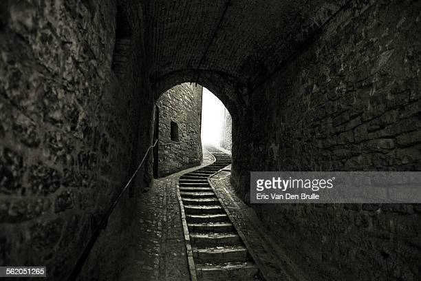 winding stone staircase in tunnel - eric van den brulle stock pictures, royalty-free photos & images