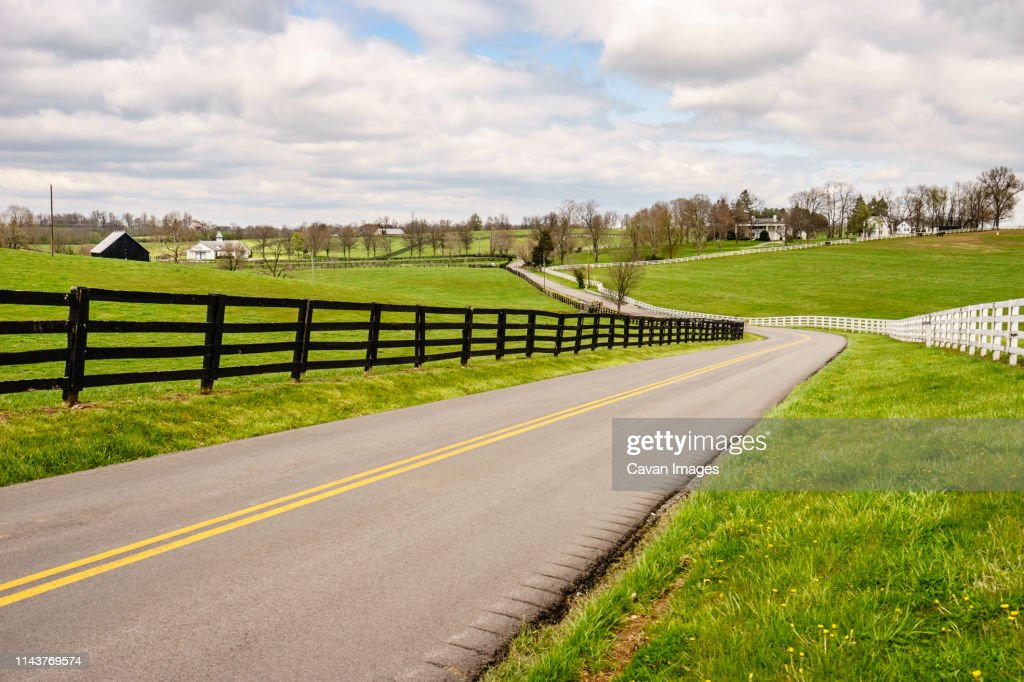 Winding two-lane rural road in bluegrass region of Kentucky : Stock Photo