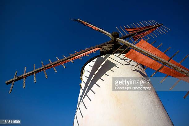 windmill against blue sky in france - traditional windmill stock photos and pictures