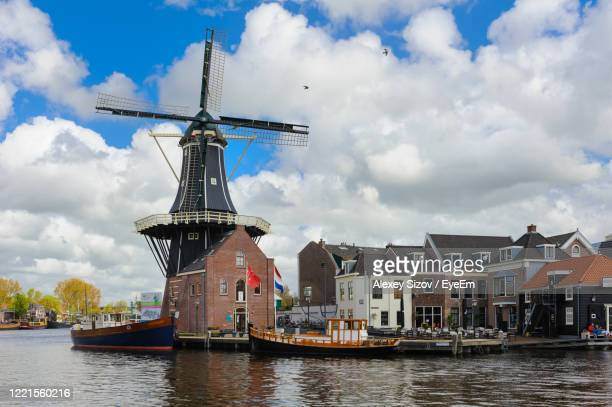 windmill against sky - netherlands stock pictures, royalty-free photos & images