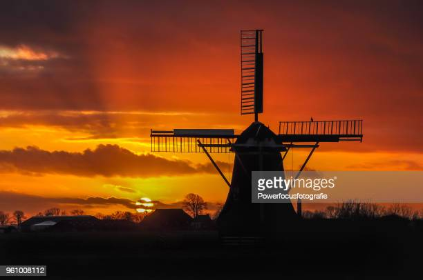 windmill against the sky - groningen province stock photos and pictures