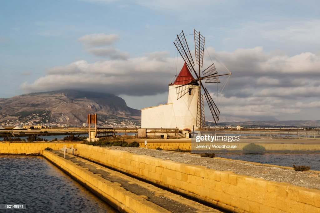Windmill among salt flats, Trapani, Sicily, Italy : Stock Photo