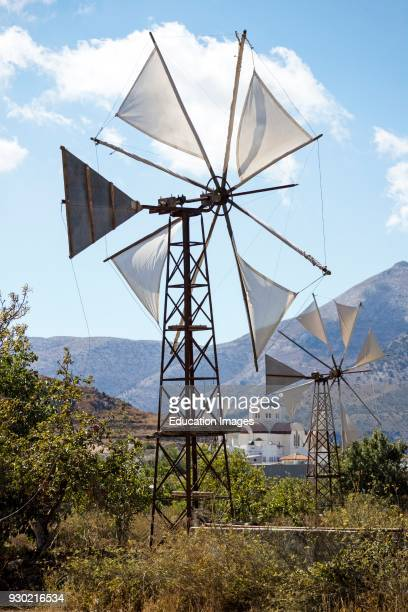 Windmill and church at Agios Georgios on the Lasithi plateau Crete Greece