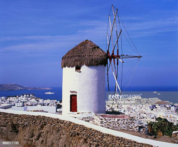 Windmill and View of Mykonos by the Coast, Cyclades, Greece