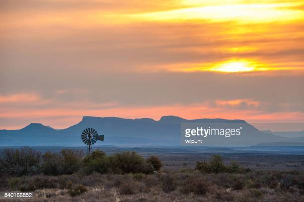 windmill at karoo sunset - the karoo stock photos and pictures