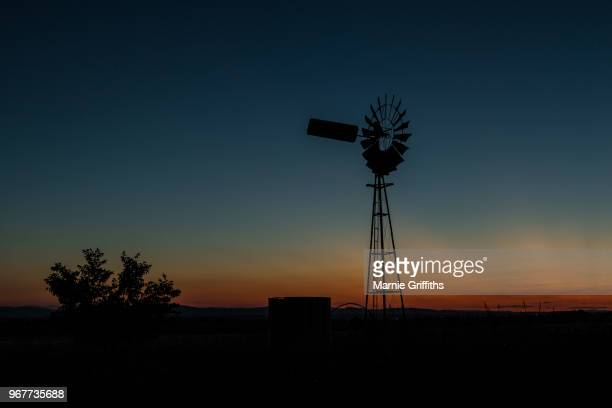 windmill at sunset - old windmill stock photos and pictures