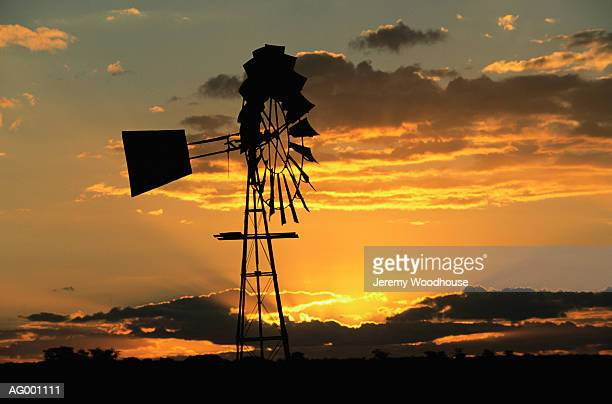 windmill at sunset - american style windmill stock pictures, royalty-free photos & images