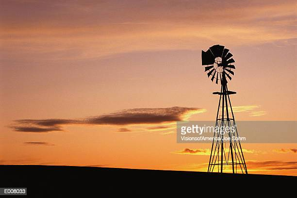 windmill at sunset, south dakota - american style windmill stock pictures, royalty-free photos & images
