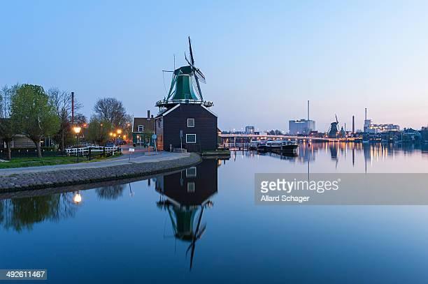 Windmill at Zaanse Schans, an industrial and national Dutch heritage site and popular tourist destination in the municipality of Zaandam,...