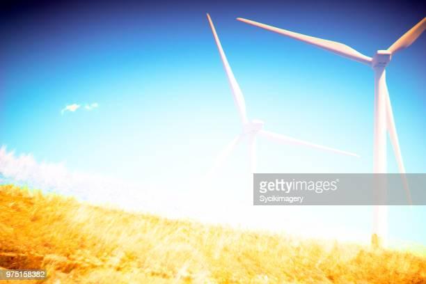 Windmill behind hillside, layered effect