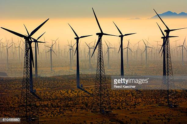 A windmill farm in low fog outside of Palm Springs, California.