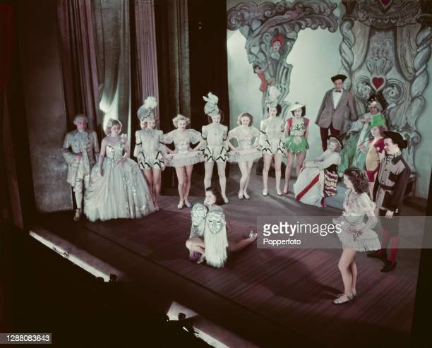 Windmill girl Beryl Catlin performs a mask dance on stage with fellow dancers and performers at the Windmill Theatre in Great Windmill Street, Soho,...