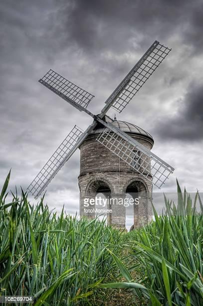 Windmill, green cornfield and stormy sky, Chesterton, Warwickshire